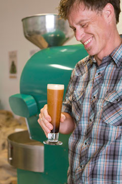 Erik Williams, Roast Master for Conundrum Coffee, checks out his draught coffee creation.